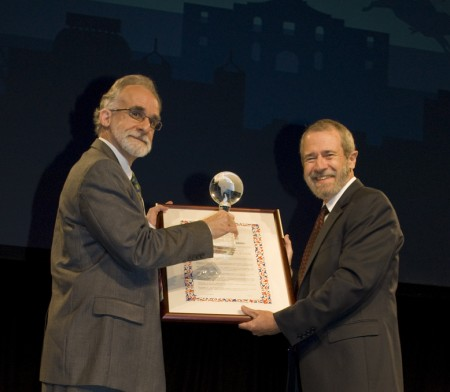 A special resolution and crystal globe presented to Jack R. Lohmann, Editor, Journal of Engineering Education. Interim Editor, Jeffrey Froyd, accepts this award on his behalf